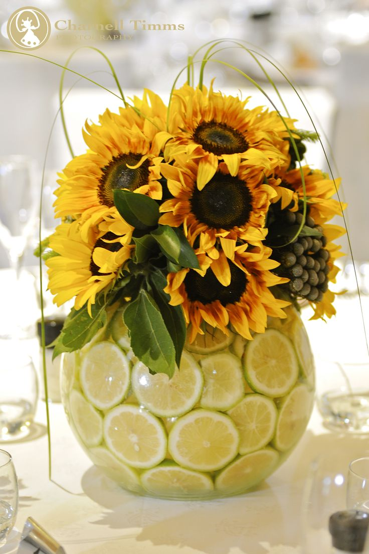 Unique sunflower and lemon table decor. Charnell Timms Photography