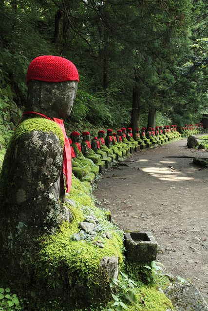 100 Jizo statues in Nikko, Japan  Red scarves in remembrance of babies gone too early- the jizo looks after those mizuko (water spirits)