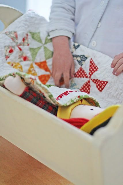 """tutorial: for a pinwheel baby doll quilt. Live how the instructions say """"quilt"""" like I know how to do that."""