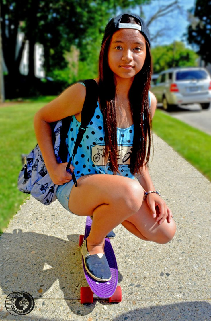 Shot of Ms. Katai on her penny board at the University of Bridgeport.