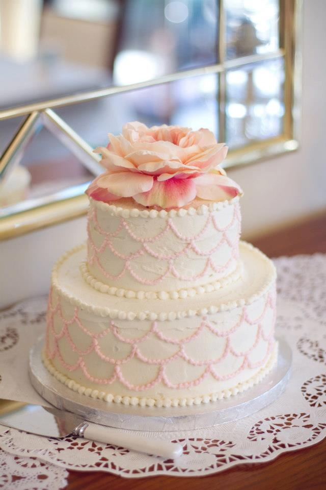 Buttercream Frosted Two Tier Cake Scalloped Detail With A Silk Flower On Top