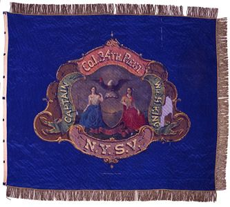 The blue, silk company color carried by Company I, 34th Regiment NY Volunteer Infantry includes a sylized Arms of the State of New York painted to the obverse complete with the company commander's name, Captain Wm. H. King (left). The reverse includes painted battle honors commemorating the company's service from October 1861 (Edward's Ferry, Maryland) to September 1862 (Antietam, Maryland) and a portrait of Revolutionary War hero Friedrich Wilhelm Augustus von Steuben (right).