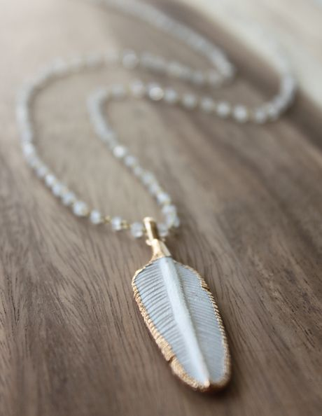 In the Native American Indian culture, feathers represented the power of the thunder gods, as well as the power of air and wind. Native American Chiefs wore them to symbolize their communication with Spirit, and to express their celestial wisdom. Our leaf charm is surrounded in vermeil and complimented with a moonstone beaded chain. moonstone is the stone of hope.