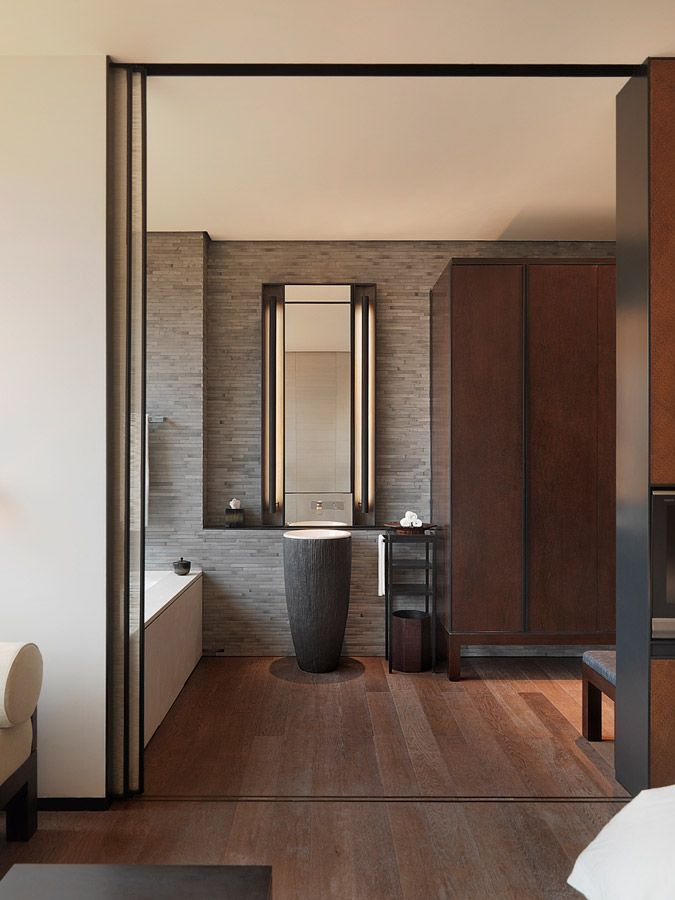 Puli Hotel. Grey stone tiles with natural woods. Square lines with round objects.