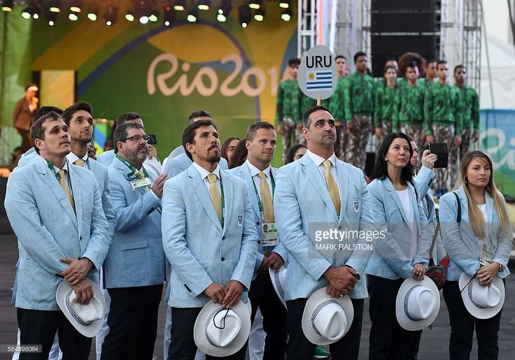 Uruguay's athletes take part in the welcoming ceremony for the Uruguayan Olympic team at the Olympic Village ahead of the Rio 2016 Olympic Games in Rio de Janeiro on July 31, 2016. / AFP / Mark RALSTON