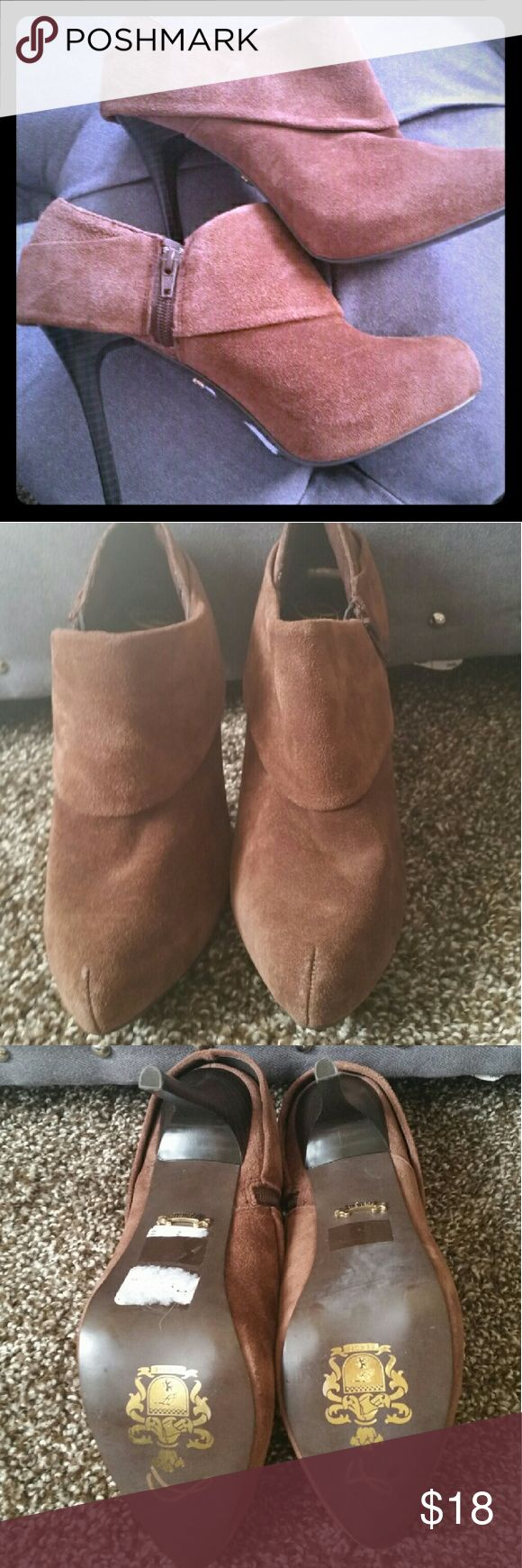 Brown Leather Fergie Booties Super cute brown leather foldover booties. Side zip. Size 8.5 - bought on a whim even though I wear a size 8.  Worn twice, their next life is with you! Fergie Shoes Ankle Boots & Booties