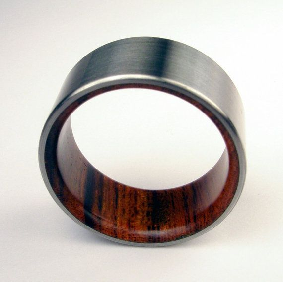 J really likes this titanium and rosewood ring...maybe we've found his ring!