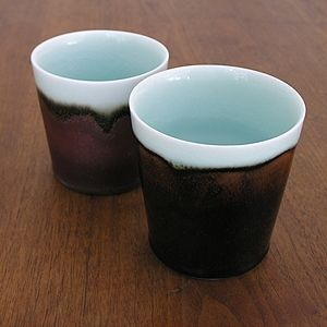 love the creamy light blue with tenmoku..Kirsten Coelho- porcelain-Mattin- gallery