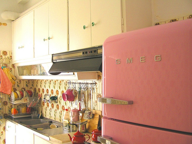 I love granny chic with a modern twist.  I love this photo because of its pink smeg fridge and the little group of utensils on the wall. ( I'm currently collecting colourful and useful utentils to go on a metal ikea rail).