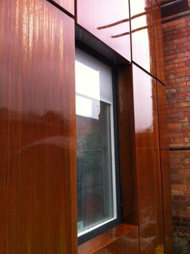 Detailed Photo Of Window Recessed Into Corten Steel