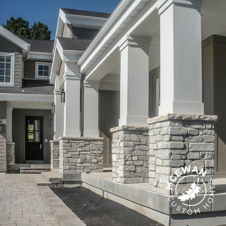 These columns adorned with stone create one... grand... entrance!  What's your style? #mcewancustomhomes #smalldetailsbigdifference #home #homebuilder #homebuilding #homedesign #design #newhome #newconstruction #custom #custombuilder #customhomes #customdesign #utahhomes #utahvalley @elcustomexteriors @joecarrickdesign