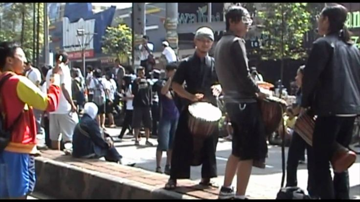 "Halo-Halo Bandung - Singing Flash Mob .f4v ""When 3 students start to play their drums"" see & feel the unity of the people from Bandung thats 1 of the reasons I love to be there....."