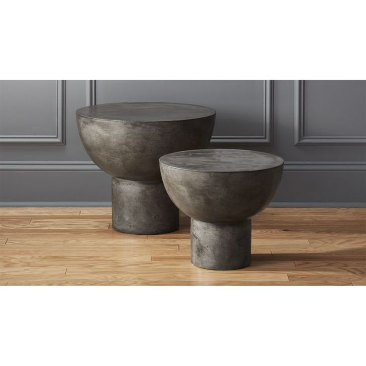 Shop bongo drum side tables.   An aggregate of marble, granite, stone and natural fibers cement this handmade table into an organic outdoor sculpture.  Maintain table's honed beauty and natural intonations with car wax or stone floor polish.
