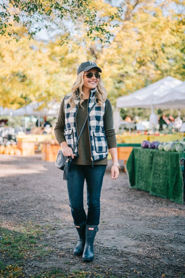 gingham vest | sweater | jeans | baseball cap | hunter boots