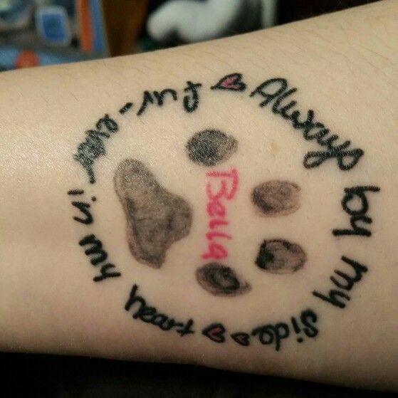 Tattoo  for my dog Bella. Her actual  paw print. I love my girl.