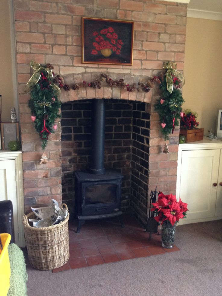 Brick fireplace at Christmas with log burner