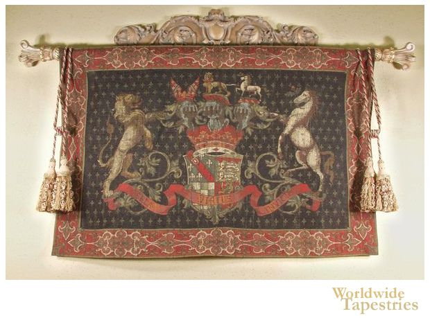 """This beautiful coat of arms tapestry """"Olde World Crest Black"""" shows a royal crest with a lion and unicorn. A central shield is seen with foliage decorations and a ribbon of calligraphy. Further miniature lion and unicorn site atop the royal crown."""
