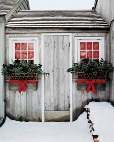 Christmas window boxes. Love the ribbon