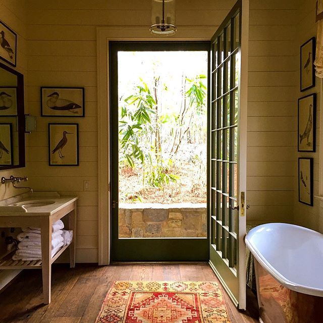 Lake Martin bathroom, open to outdoors, shiplap walls - home of Architect Bill Ingram