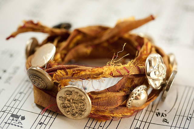 silk shipwrecked bracelet, via Flickr.  sari silk ribbon with buttons