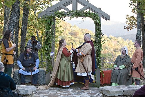 Viking wedding, Asatru, pagan, old folk, Icelandic, Nordic traditional clothes tunic, ribbon trimming. With amazing Viking styled cake,