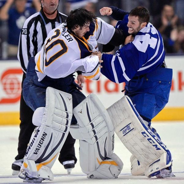Buffalo Sabres goalie Ryan Miller fights with Toronto Maple Leafs goalie Jonathan Bernier