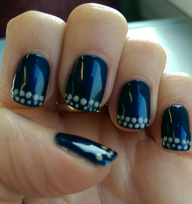 Navy blue nails with dotty spotty taupe french tip
