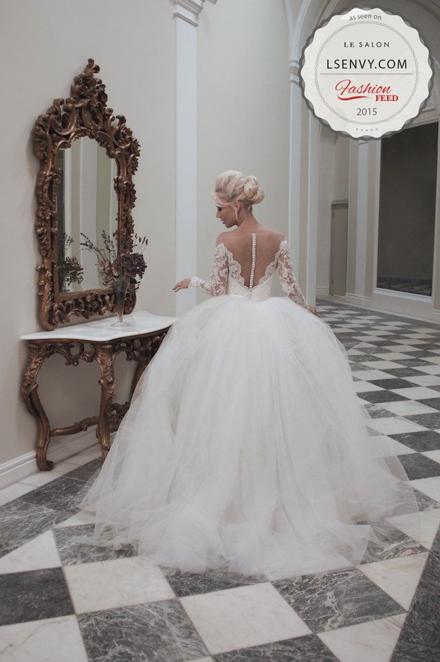 Love the combination of the full skirt and long sleeves with the sexy low back…