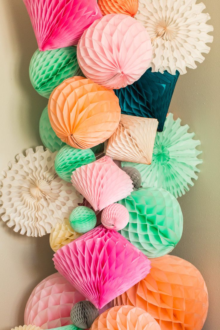 I've got to have this! Honeycomb diamonds and honeycomb balls with tissue paper fans makes a dramatic display. I love the variety of colors and sizes. www.soireesupply.etsy.com