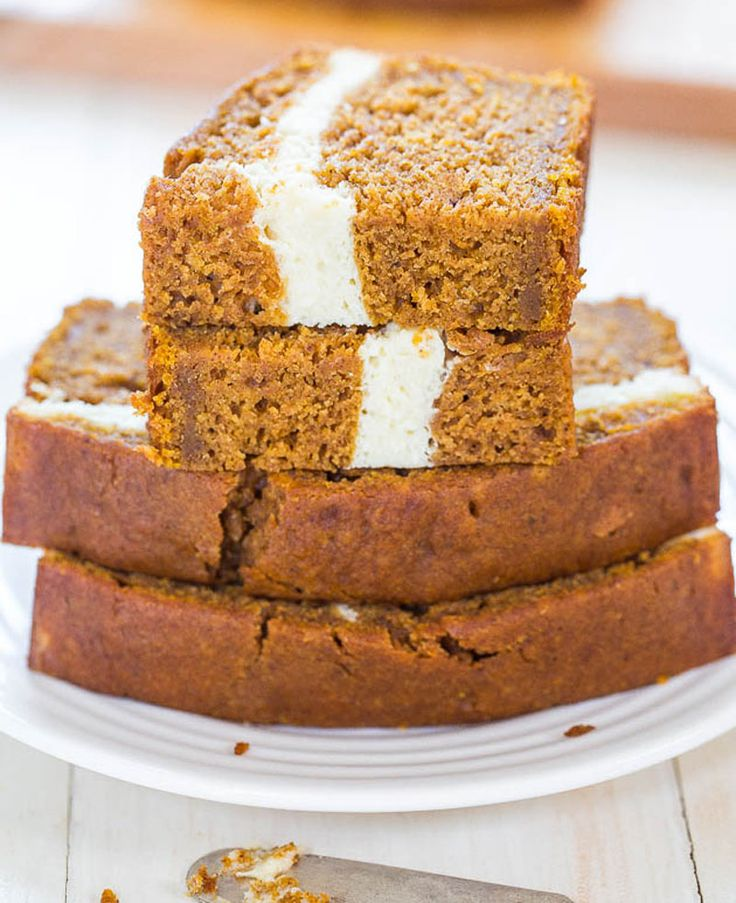 Pumpkin bread with a drool-worthy creamy layer for less than 200 calories a serving? Is it calling your name yet? This recipe yields two loaves of delicious bread at 8 slices per loaf. Enjoy its swirly, creamy goodness!