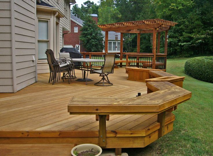 Instead of an arbor, how about a tiki bar, two levels with a stone dining patio on the other side (don't forget the fire pit on the patio edge and maybe a water feature on the other side?)