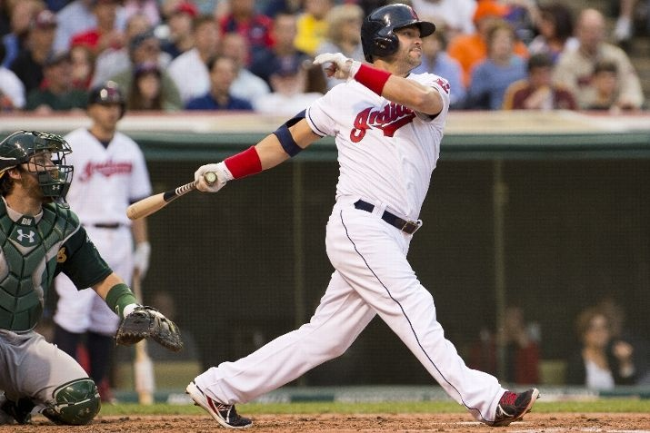 Nick Swisher #33 of the Cleveland Indians hits a single during the 3rd inning against the Oakland Athletics at Progressive Field on May 6, 2013 in Cleveland, Ohio. (Photo by Jason Miller/Getty Images)