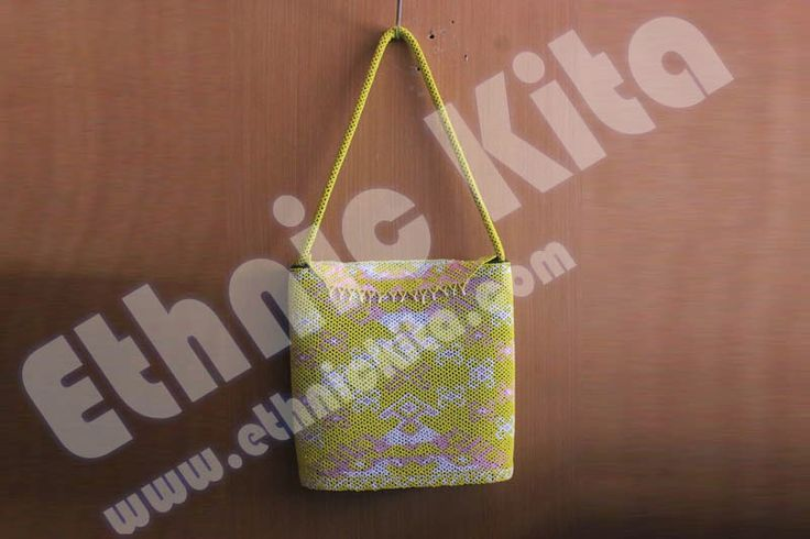"Beaded Handbags with ""Borneo Motif"".    Measurements : Hight: 28cm x Width: 28cm   Material : Beadeds from kalimantan   Basic Color : Yellow   Motif : White pink borneo motif   Ethnic Of : Kalimantan, Indonesia"