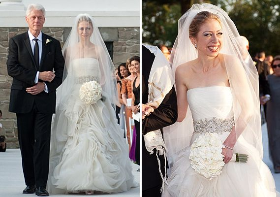 President Bill Clinton walked his daughter, Chelsea, down the aisle in a strapless Vera Wang wedding dress with a raw-edged laser cut swirling silk organza ball skirt and train. The diagonally draped bodice was made with silk tulle and accented by an embellished belt. For the reception, Chelsea changed into a silk tulle Grecian Vera Wang gown with a criss cross back and narrow grosgrain black belt.