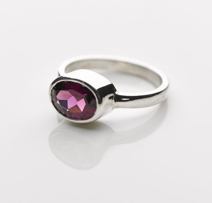 Large oval Rhodolite set in a sterling silver band