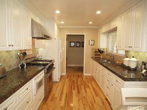 Contemporary Kitchen with Stonemark Granite-Granite Countertop in Baltic Brown