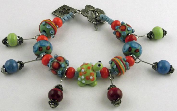 Lampwork glass beads.  Fun bright colored beads including a fun green turtle.
