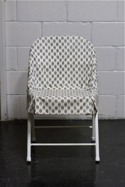 Cover up boring or ugly folding chairs with fun patterned fabric with this simple chair slipcover tutorial that Amanda from Spruce shared on Design Sponge!
