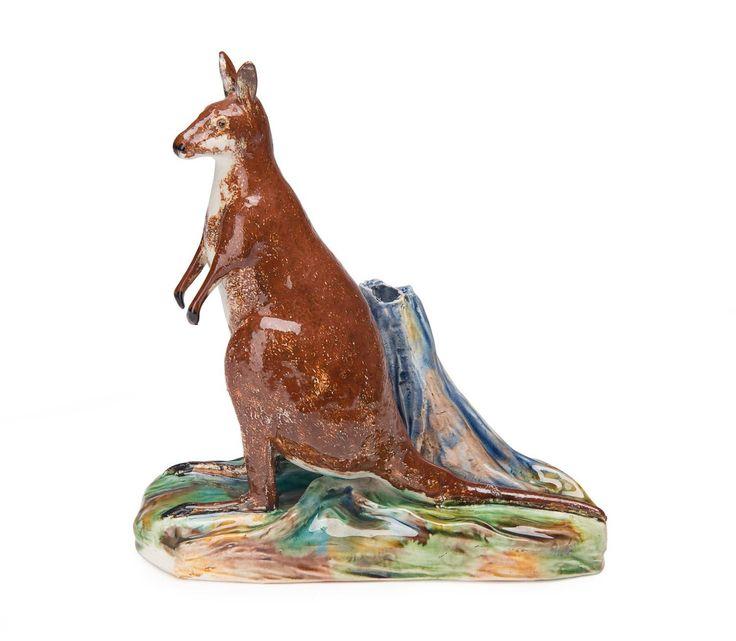 Grace Seccombe (1880-1956) A slip cast, hand-finished, earthenware figure of a kangaroo standing alongside a tree stump 1942 - Price Estimate: $2000 - $3000