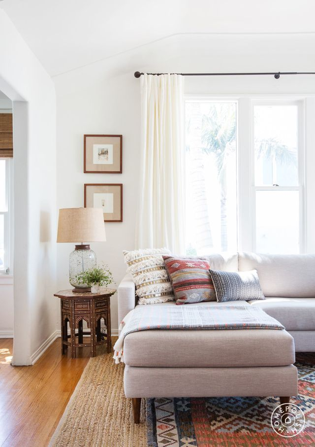 Celebrate endless summer vibes by touring this warm, eclectic family home at the beach.