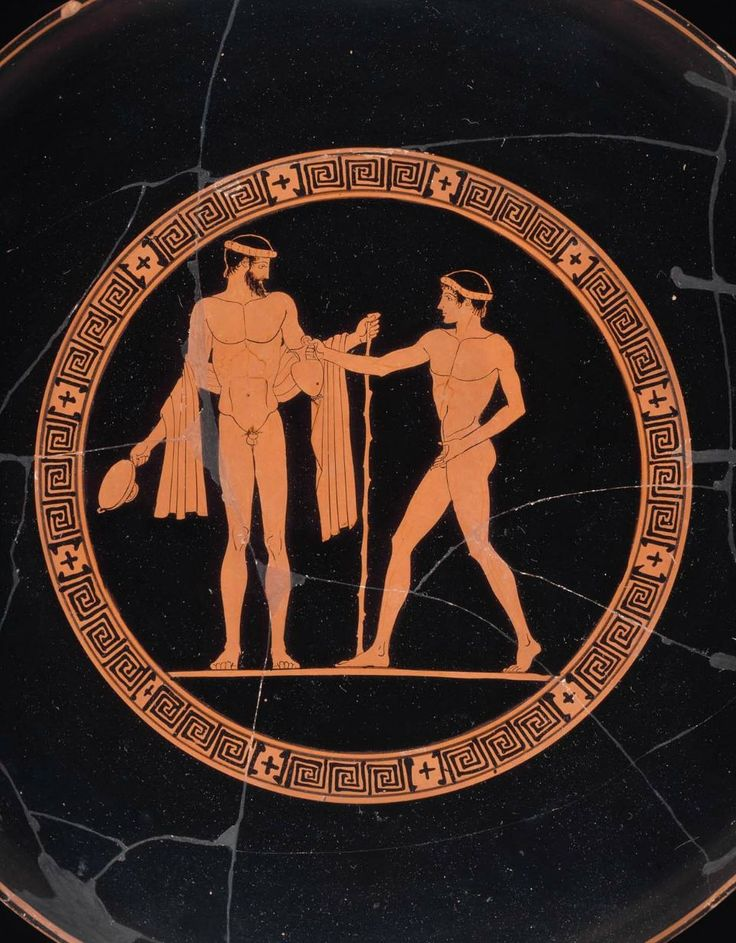 Drinking cup (kylix) with symposium scenes