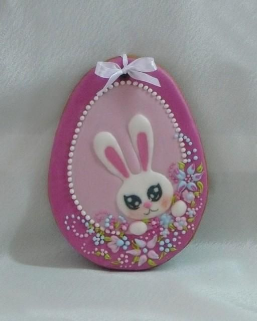 Easter cookie .. egg shaped ... royal icing .. pinkis ... bunny head ...