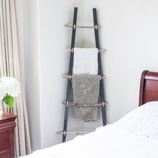 Create a simple, coastal-inspired blanket ladder with driftwood pieces and copper clamps. An easy step-by-step tutorial is included.