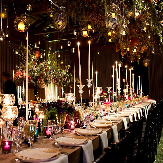 """Brides.com: A Glamorous, Rustic Wedding in Utah. The """"enchanted forest"""" theme was aided by a 30-foot chandelier of fall foliage, a sod floor, and smoke machines that replicated dewy mist.  Browse more rustic reception ideas."""