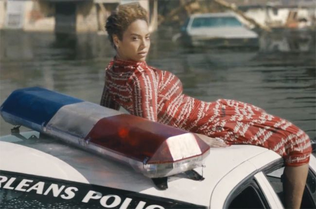 """Beyoncé's """"Formation"""" video is a prime example of how lyrics and its images spark conversation. The politically charged music video makes multiple social commentaries on the Black Lives Matter movement and Hurricane Katrina. It reaches out to the communities who are both outraged at what is occurring in our day, but also to those who have come to embrace their blackness and their culture. The video itself is a reminder of how many social injustices must be resolved."""