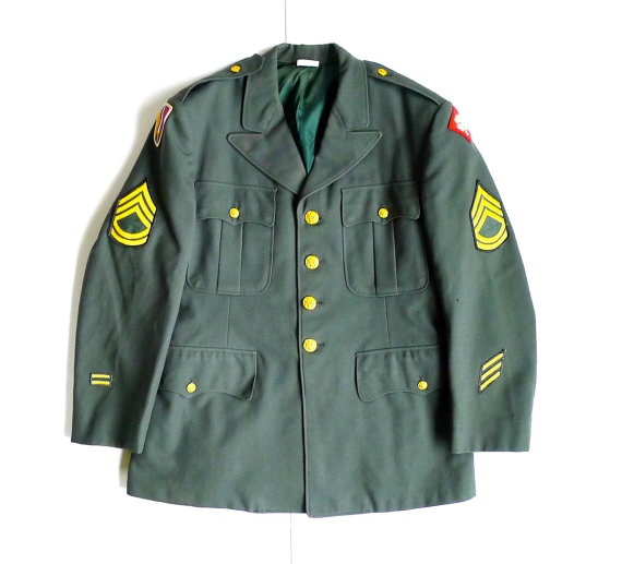 """Vintage Vietnam era US Army uniform jacket. Size is a 41S. Shoulders measure 19"""", sleeve from shoulder to wrist 23-3/4"""", underarm from seam to seam is 21"""", length approx. 29-1/2"""". Two small holes on left sleeve and one small one on the backside. No stains or odors, the light is causing a darker effect on the collar. Fabric is wool. Patches date this jacket to the Vietnam era. Patch on right arm is a 6th Battalion patch with a sword issued between September 1965 through September of 1968."""