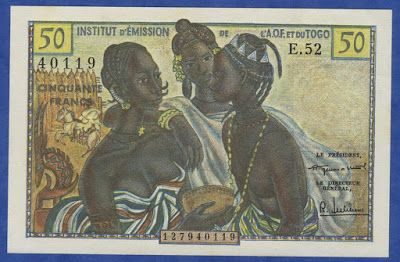 French West African currency 50 Francs banknote of 1956, issued by the Institut d'Emission de l'Afrique Occidentale Francaise et du Togo.  French West Africa banknotes, French West Africa paper money, French West Africa bank notes.  Obverse: African women dressed in traditional colorful clothes and with afro braided hairstyle. Reverse: African attractive young woman with traditional headdress and aerial view of Abidjan in background.