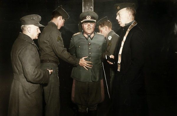 Nazi General Anton Dostler is tied to a stake before his execution for killing 15 OSS men.