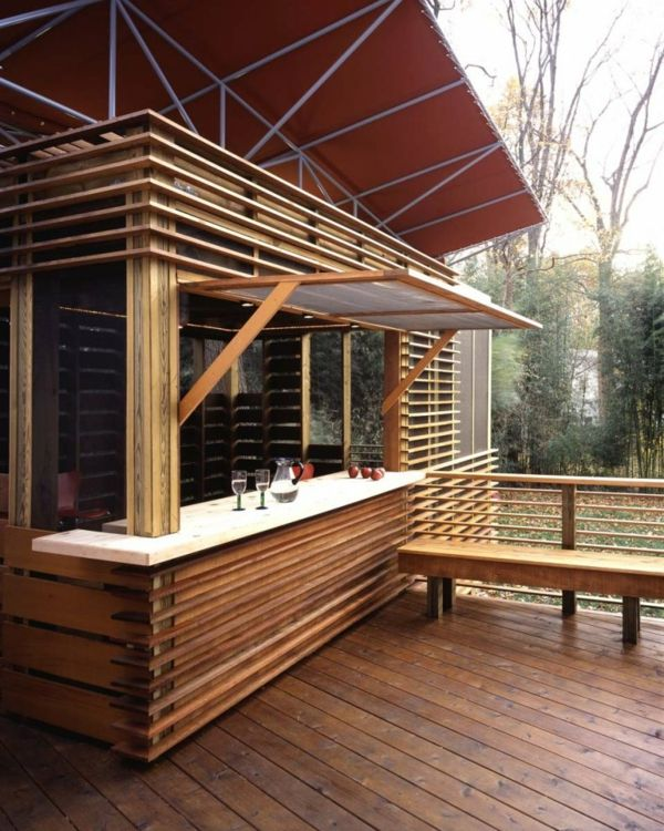 This is a a relatively modest small wooden summer house but its inventive construction provides endless pleasure for the family who commissioned it. They have endless opportunities to fully enjoy relaxing and entertaining outside during the summer. Due to the remarkably flexible construction of the butterfly porch, they may extend these activities to seasons when the weather may be less clement and more unpredictable.