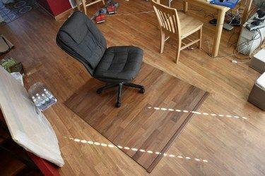 Might have to do this...Painting laminate floors